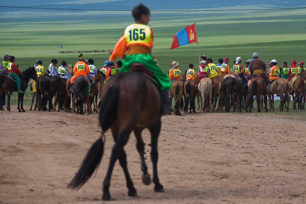 Mongolia - Edward Wong - Horse Race<br /> <br /> Jockeys gather to leave for a start line before the horse race in Khui Doloon Khudag, Mongolia, July 10, 2008. Participants of this weekend's horse race during Naadam festival gather the area to practce. Children from 5 to 13 are chosen as jockeys. Photo by Shiho Fukada for The New York Times