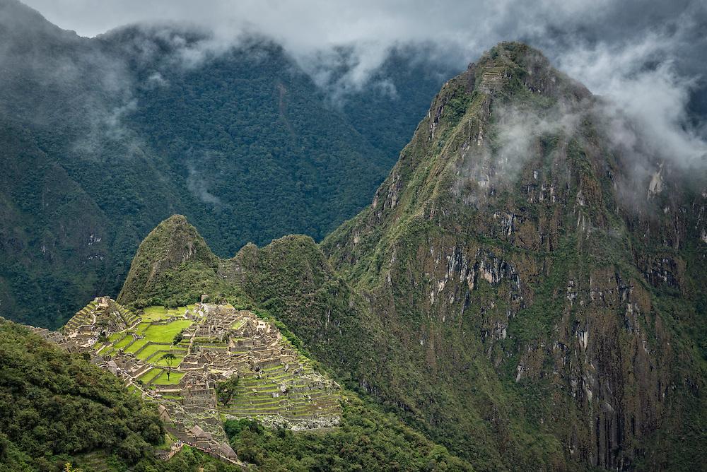 Machu Picchu and Huayna Picchu Peak from the Inca Trail below Sun Gate; Machu Picchu, Peru.