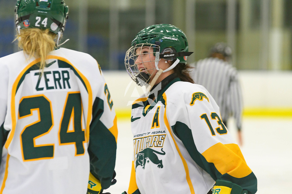 5th year forward Kylie Gavelin (13)  & 1st year forward Merissa Zerr (24) of the Regina Cougars of the Regina Cougars in action during the Women's Hockey Home Game on October 15 at Co-operators arena. Credit: Arthur Ward/Arthur Images