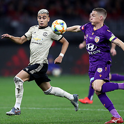 Andreas Pereira of Manchester United takes on Shane Lowry of Perth Glory