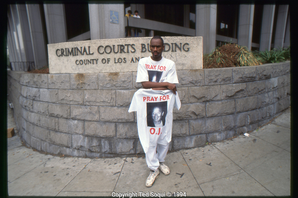 The OJ Simpson trial and media circus.<br /> A tee shirt vendor outside the Criminal Courts Building.