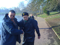LIVERPOOL, ENGLAND - Tuesday, February 19, 2008: Dog owner Mike thanks Jon Warren, 52 of Glendale, from after he rescued his dog from the frozen Sefton Park Boating Lake. (Pic by David Rawcliffe/Propaganda)