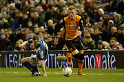 Hull City midfielder Sam Clucas skips past Birmingham City defender Paul Caddis during the Sky Bet Championship match between Birmingham City and Hull City at St Andrews, Birmingham, England on 3 March 2016. Photo by Alan Franklin.
