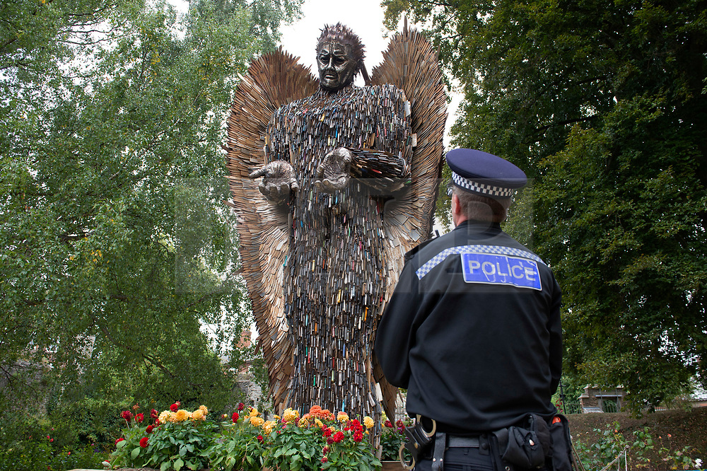 ©Licensed to London News Pictures 11/09/2019.<br /> Rochester ,UK.The Knife angel is in Kent.<br /> The huge eight metre high sculpture which is made from confiscated knives is on display in Rochester cathedral gardens, this is the first time it has been installed in the South East. The sculpture was made by artist Alfie Bradley in collaboration with the British Ironwork centre with more than 100.000 knivies supplied by 43 police forces across the UK.Photo credit: Grant Falvey/LNP