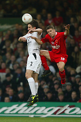 CARDIFF, WALES - Sunday, March 2, 2003: Liverpool's Michael Owen and Manchester United's Gary Neville challenge for a header during the Football League Cup Final at the Millennium Stadium. (Pic by David Rawcliffe/Propaganda)