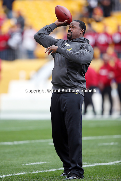 Pittsburgh Steelers outside linebackers coach Joey Porter throws a pregame pass while the team warms up before the 2015 NFL week 6 regular season football game against the Arizona Cardinals on Sunday, Oct. 18, 2015 in Pittsburgh. The Steelers won the game 25-13. (©Paul Anthony Spinelli)