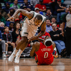 Dec 13, 2017; New Orleans, LA, USA; New Orleans Pelicans center DeMarcus Cousins (0) collides with Milwaukee Bucks forward Khris Middleton (22) during the second quarter at the Smoothie King Center. Mandatory Credit: Derick E. Hingle-USA TODAY Sports