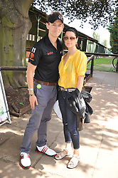 Actor JJ FIELD and actress NEVE CAMPBELL at the Leuka Mini Masters Golf at Dukes Meadows, Chiswick, London on 15th July 2011.