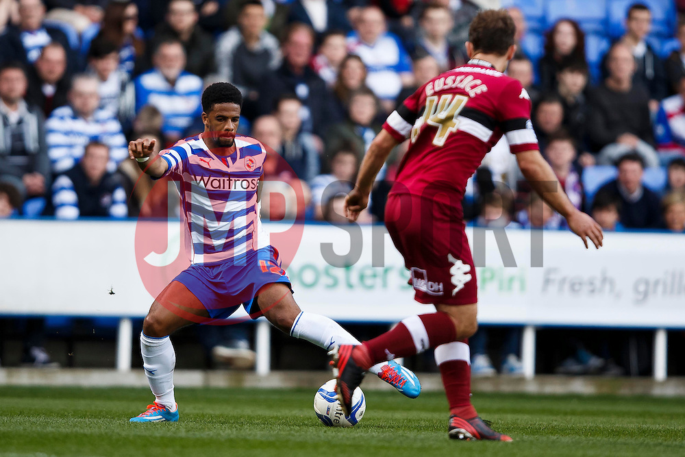 Reading Forward Garath McCleary (ENG) is challenged by Derby Midfielder John Eustace (ENG) - Photo mandatory by-line: Rogan Thompson/JMP - 07966 386802 - 15/09/2014 - SPORT - FOOTBALL - Madejski Stadium - Reading - Reading v Derby County - Sky Bet Football League Championship.
