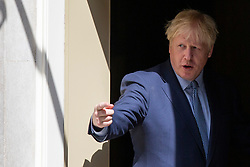 © Licensed to London News Pictures. 06/08/2019. London, UK. Prime Minister Boris Johnson returns to 10 Downing Street for a meeting after shaking hands with Estonian Prime Minister Jüri Ratas .The meeting takes place during Ratas' private visit to London. Photo credit: George Cracknell Wright/LNP