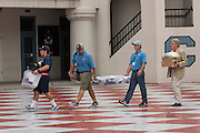 An incoming Citadel freshman and parents move into the barracks during matriculation day on August 17, 2013 in Charleston, South Carolina. The Citadel is a state military college that began in 1843.