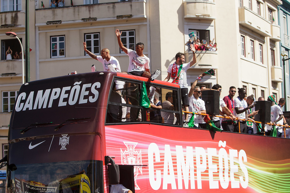Portuguese football players while travelling in a bus through Lisbon streets being greeted by portuguese supporters. Portugal's national squad won the Euro Cup the day before, beating in the final France, the organizing country of the European Football Championship, in a match that ended 1-0 after extra-time.