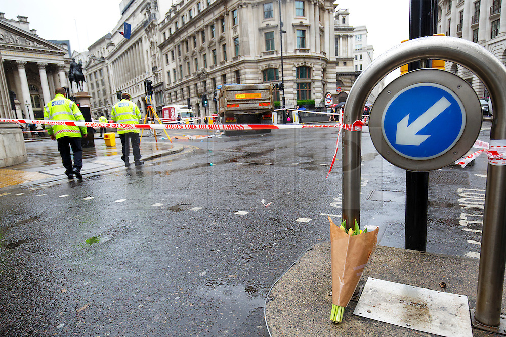 © Licensed to London News Pictures. 22/06/2015. London, UK. Flowers left for a female cyclist died in a crash with a tipper truck at Bank junction in London during morning rush hour on Monday, June 22, 2015. Photo credit: Tolga Akmen/LNP