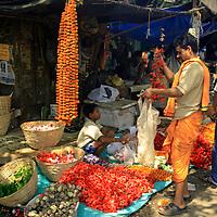 Asia, India, Calcutta. Shopping at the flower market in Calcutta.