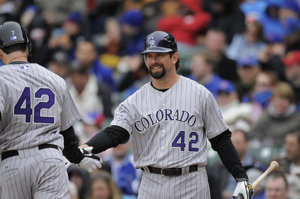 CHICAGO - APRIL 15:  Todd Helton #17 of the Colorado Rockies greets Seth Smith #7 after Smith hit a home run against the Chicago Cubs on April 15, 2009 at Wrigley Field in Chicago, Illinois.  All players wore number 42 on this day only in honor of Jackie Robinson.  The Rockies defeated the Cubs 5-2.  (Photo by Ron Vesely)