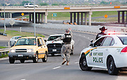 Military police direct traffic outside Fort Hood military base near Killeen, TX on Wed. April 2, 2014 after an active shooter wounded 14 people.  The shooter died on scene.