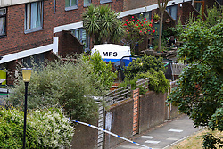 © Licensed to London News Pictures. 06/06/2020. London, UK. Police tent in a back garden of a property on Brackenfield Close, Hackney in East London as police launch an investigation following a fatal shooting. Police were called at 11.30 pm on Friday 5 June, to reports of shots fired in Brackenfield Close and found a man in his twenties suffering gunshot injuries. Despite the efforts of medics and officers, the man was pronounced dead at the scene. Photo credit: Dinendra Haria/LNP