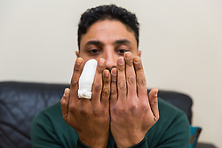 Amazon delivery driver Husam Aljuburi, 29, of Ealing, West London, lost the top quarter of his middle finger after tearing it off in a letterbox as he delivered a parcel at a home in Slough. London, April 09 2019.