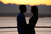 Couple, boy, girl, romance, romantic moment, cruise ship, cruise, Seattle, Washington State, USA, sunset, evening, twilight, lovers, 200809141472.<br />