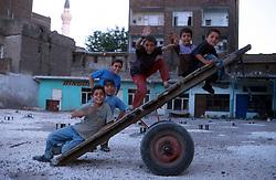 TURKEY DIYARBAKIR JUL02 - Kurdish boys playfully convert a freight cart into an instant swing in Diyarbakir, the unofficial Kurdish capital on Turkish territory...jre/Photo by Jiri Rezac..© Jiri Rezac 2002..Contact: +44 (0) 7050 110 417.Mobile:  +44 (0) 7801 337 683.Office:  +44 (0) 20 8968 9635..Email:   jiri@jirirezac.com.Web:     www.jirirezac.com