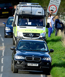 © Licensed to London News Pictures. 23/04/2016. Chandler's Cross, UK. An anti-terrorism police unit (front in BMW car) watch as President of The United States of America, BARAK OBAMA, plays golf with British prime minister DAVID CAMERON at The Grove golf Course in Chandler's Cross, Hertfordshire. Photo credit: Ben Cawthra/LNP