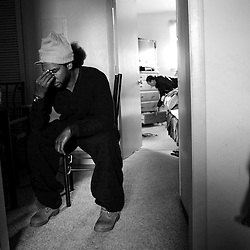 Kyle Green | The Roanoke Times<br /> 2/20/2012 Edward &quot;Zulu&quot; Hicks pauses in frustration as his girlfriend Angela Legans (back) gathers up belongings from their apartment. The couple are on their way to stay in a hotel after almost 24 hours after a snowstorm knocked out power to their apartment on Gilmer Avenue SW in Roanoke, Virginia. The couple, who live paycheck to paycheck, have borrowed money from a friend to stay in a hotel for the next two days after being told by AEP that the power may not be restored to their apartment until late Wednesday night. Appalachian Power Co. at 12:30 p.m. reported approximately 9,400 customers without power in Roanoke and Roanoke County.