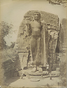 The caption on the back reads The Kalawewa Buddha. it is now known as the Aukana Buddha.<br /> Skeen &amp; Co. Photographs of the historical sites of Ceylon.