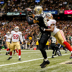 Nov 9, 2014; New Orleans, LA, USA; New Orleans Saints tight end Jimmy Graham (80) catches a touchdown past San Francisco 49ers cornerback Perrish Cox (20) during the fourth quarter of a game at Mercedes-Benz Superdome. The 49ers defeated the Saints 27-24 in overtime. Mandatory Credit: Derick E. Hingle-USA TODAY Sports