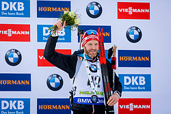 Simon Eder (AUT) during Flower ceremony after the Men 20km Individual at day 5 of IBU Biathlon World Cup 2018/19 Pokljuka, on December 6, 2018 in Rudno polje, Pokljuka, Pokljuka, Slovenia. Photo by Ziga Zupan / Sportida
