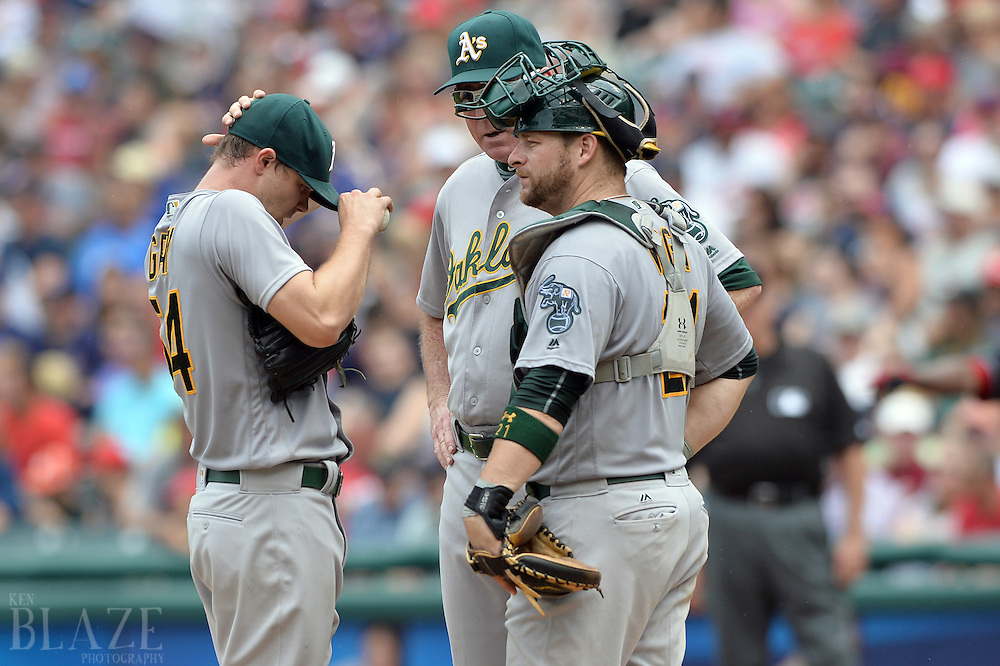 Jul 31, 2016; Cleveland, OH, USA; Oakland Athletics pitching coach Curt Young (41) and catcher Stephen Vogt (21) talk with starting pitcher Sonny Gray (54) during the fourth inning at Progressive Field. Mandatory Credit: Ken Blaze-USA TODAY Sports