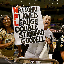 Sep 21, 2014; New Orleans, LA, USA; New Orleans Saints fan Larry Rolling holds up a sign in reference to NFL commissioner Rodger Goodell following a win over the against the Minnesota Vikings at Mercedes-Benz Superdome. The Saints defeated the Vikings 20-9. Mandatory Credit: Derick E. Hingle-USA TODAY Sports