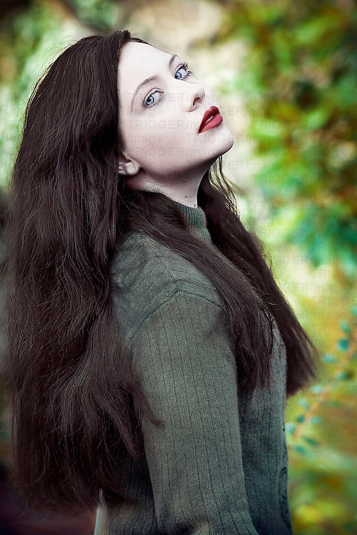 A girl with dark hair looking at the camera.