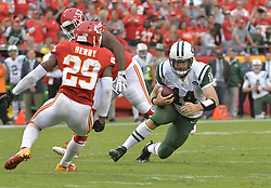 Sep 25, 2016; Kansas City, MO, USA; New York Jets quarterback Ryan Fitzpatrick (14) runs the ball as Kansas City Chiefs strong safety Eric Berry (29) attempts the tackle during the second half at Arrowhead Stadium. The Chiefs won 24-3. Mandatory Credit: Denny Medley-USA TODAY Sports