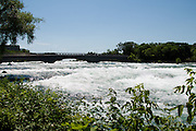 The lower rapids flow through Niagara Falls State Park on July 1, 2012 in Niagara Falls, New York. (David Welker/www.Turfimages.com).