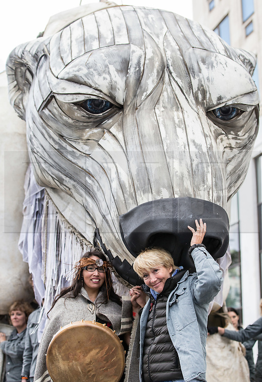 © Licensed to London News Pictures. 02/09/2015. London, UK. Actress Emma Thompson pictured outside the Shell Building on the Southbank today with Audrey Siegl, A First Nations activist from Canada, and 'Aurora', a large human operated Polar Bear built by Greenpeace activists who intend to picket outside the oil company's headquarters until they abandon plans to drill for oil in the Arctic. Photo credit : James Gourley/LNP