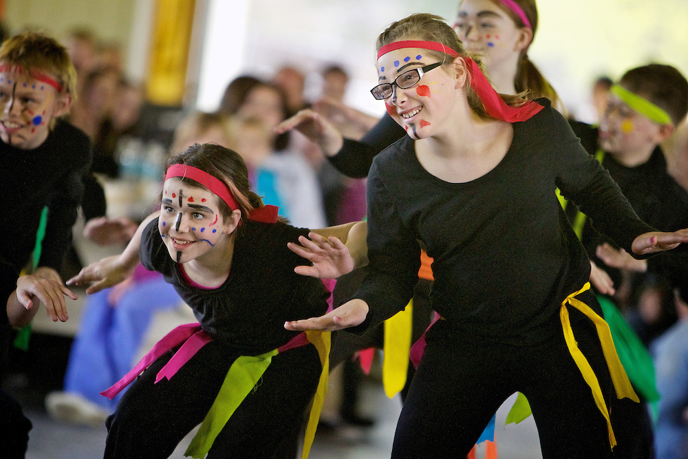 Lilly Bower, left, and Sydney Schumacker, members of the Seltice Elementary Zumba Dancers, perform during the Post Falls Mayor's Youth Awards event Thursday at Q'emiln Park. The Seltice Elementary Zumba Dancers were nominated for a group mayor's award for ages 8-11.