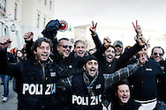Italian policemen celebrate outside the Police's headquarters in Caserta following the arrest of the boss of the Casalesi clan on December 7, 2011. Italian police on Wednesday arrested Michele Zagaria, 53, the most senior boss of the Camorra mafia still at large, digging through a secret bunker near Naples to end his 16 years on the run. Ph. AFP PHOTO / ROBERTO SALOMONE