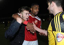 Swindon Town's Jonathan Obika puts his arm around a fan  - Photo mandatory by-line: Dougie Allward/JMP - Mobile: 07966 386802 - 11/05/2015 - SPORT - Football - Swindon - County Ground - Swindon Town v Sheffield United - Sky Bet League One - Play-Off