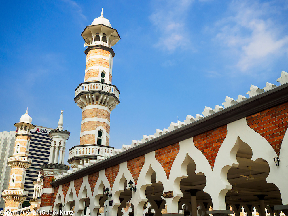 06 JUNE 2015 - KUALA LUMPUR, MALAYSIA: One of the minarets of the Masjid Jamek. Masjid is the Bahasa word for mosque. Built in 1909, Jamek Mosque is one of the oldest mosques in Kuala Lumpur. It is located at the confluence of the Klang and Gombak River and was designed by Arthur Benison Hubback. The mosque was a built in the style of Mughal (northern India) architecture. Before the national mosque, Masjid Negara, was opened in 1965, Masjid Jamek served as Kuala Lumpur's main mosque.      PHOTO BY JACK KURTZ