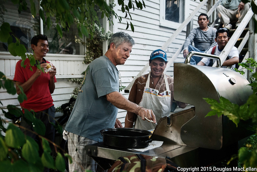 Jorge Valdivia, a union member, grills corn at a barbecue for migrant workers at the Agricultural Workers Alliance Support Centre in Leamington. There was an excellent turnout of mostly Hispanic speaking men but no shortage of food.