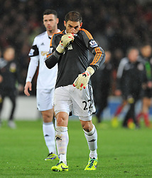 Replacement Goal keeper Swansea City's Angel Rangel Kisses the swansea badge on his shirt. - Photo mandatory by-line: Alex James/JMP - Tel: Mobile: 07966 386802 03/11/2013 - SPORT - FOOTBALL - The Cardiff City Stadium - Cardiff - Cardiff City v Swansea City - Barclays Premier League