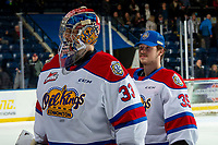 KELOWNA, BC - NOVEMBER 26:  Sebastian Cossa #33 and Todd Scott #35 of the Edmonton Oil Kings exit the ice after the shoot out win against the Kelowna Rockets at Prospera Place on November 26, 2019 in Kelowna, Canada. (Photo by Marissa Baecker/Shoot the Breeze)