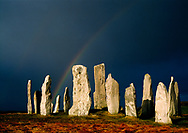 Callanish prehistoric stone circle on Outer Hebrides island of Lewis, Scotland. Over 5000 years old. Winter storm sky rainbow