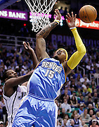 Denver Nuggets forward Carmelo Anthony (15) is fouled by Utah Jazz forward C.J. Miles, left, during the first half of Game 4 of the NBA Western Conference first-round playoff series in Salt Lake City, Sunday, April 25, 2010. (AP Photo/Colin E Braley)