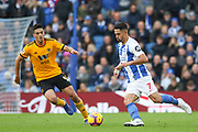 Brighton and Hove Albion midfielder Beram Kayal (7) battles with Wolverhampton Wanderers forward Raul Jimenez (9) during the Premier League match between Brighton and Hove Albion and Wolverhampton Wanderers at the American Express Community Stadium, Brighton and Hove, England on 27 October 2018.