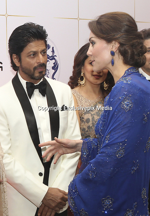 April 10, 2016 - Mumbai, INDIA - <br /> <br /> Kate, the Duchess of Cambridge, right, speaks with Bollywood star Shah Rukh Khan, during a charity ball at the Taj Mahal Palace hotel in Mumbai, India, Sunday, April 10, 2016. The royal couple began their weeklong visit to India and Bhutan, by laying a wreath at a memorial Sunday at Mumbai iconic Taj Mahal Palace hotel, where 31 victims of the 2008 Mumbai terrorist attacks were killed.<br /> ©Exclusivepix Media