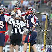 Paul Rabil #99 of the Boston Cannons high fives Ryan Boyle #14 of the Boston Cannons during the game at Harvard Stadium on May 17, 2014 in Boston, Massachuttes. (Photo by Elan Kawesch)