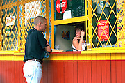 Man age 22 talking to friend age 19 at concession stand.  Gdynia Poland