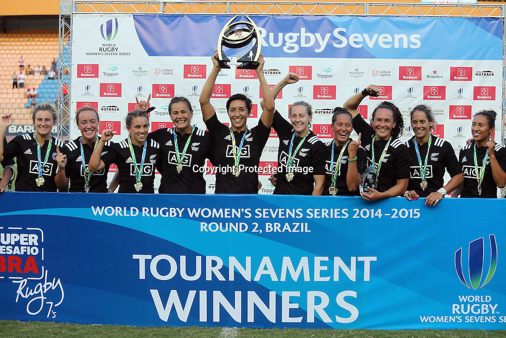Sarah Goss lifts the Brazil Sevens trophy after New Zealand beat Australia 17-10 in the final in Sao Paulo.