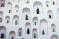 June 1995, Quito, Ecuador --- Religious Figurines in Wall Niches --- Image by © Owen Franken/CORBIS